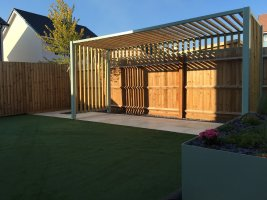 a wooden pergola and planter in a modern garden space
